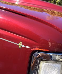 The pin-striping on this truck is a little fireman putting out a miniature painted on decal of a speed flame. - Imgur
