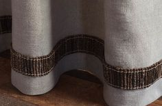 """From Samuel and Sons, the La Terre Branch Border consists of a row of 2"""" hand-tied coconut branches and is idea for drapery as well as upholstery."""