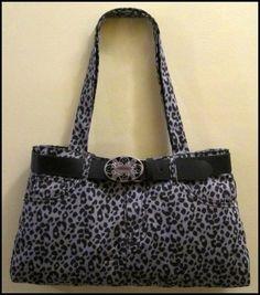 Black & Grey Leopard Jean handbag black belt.  https://poshmark.com/closet/haveheartdailys?availability=all&spt=true