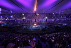 The Olympic torch is lit during the Opening Ceremony at the 2012 Summer Olympics, Friday, July 27, 2012, in London