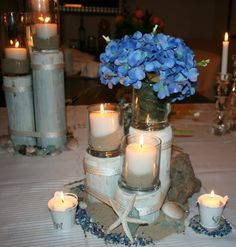 Wedding PIER/PILLAR Centerpiece and surrounding room decor- Three piers-Three Tiers Nautical Centerpiece, Centerpieces, Table Decorations, Centerpiece Ideas, Metallic Blue Paint, Candels, Glass Candle Holders, Special Events, Special Occasion