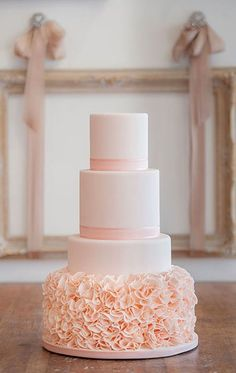 This is just one beautiful wedding cake. Peach, ruffles details all the way!