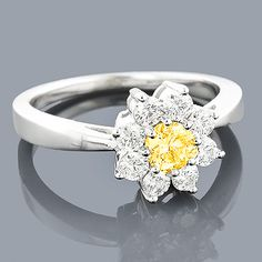 Beautiful White and Yellow Diamond Cluster Rings: This 14K Diamond Daisy Ring showcases 1.3 carats of sparkling round diamonds set in a cluster/flower design. Featuring a lovely yellow diamond in the center and a highly polished gold finish, this ladies diamond ring makes a fabulous pre-set diamond engagement ring or a 7 year anniversary gift, and is available in 14K white, yellow and rose gold.
