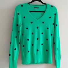 TOMMY Hilfiger polka dot knit top Green with navy blue dots. Knit top V-neck long sleeve New w/o tags never worn      Size small SAMPLE piece. Tommy Hilfiger Tops