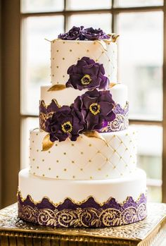 Purple and gold wedding cake, Claudia doesn't like the flowers so take those off