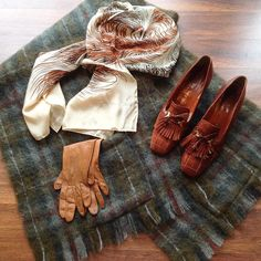 """Lots of lovely fall friendly pieces in the shop  New inventory weekly. Come on by and say hello! Mohair shawl with pockets $40 Oscar de la Renta silk feather print scarf $15 70s fridge quilted loafers w/ 2"""" block heel 
