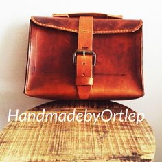 New style men bag.  All #handmade #leather #wallets with card and paper places, bags, bracelets and more. Now order you're #custom #handmade #leather product  @handmadebyortlep. By email dubbelo@me.com.   #rogierbarbier #fashion #2015 #shopper #shop #webshop #barbier #barbierrogier #genuine #leathercraft #leatherstitched #handstitched #leatherwork #barberpole #barbertools