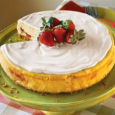 Irish Strawberry-and-Cream Cheesecake - Smooth cream cheese combined with the wonderful flavors of Irish cream liqueur and strawberry preserves are just the beginning                                         of this decadent dessert. Finish by spreading sour cream evenly over the cheesecake and garnishing with whole strawberries.
