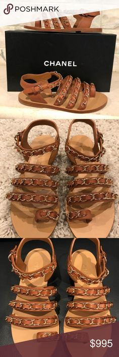 """Chanel 17C Brown Beige Chain CC Gladiator Strap Chanel 17C Brown Beige Chain CC Gladiator Strap Mule Slide Flat Sandal 37.5  ********** Chanel **********  Brand: Chanel Size: 37.5 (know your Chanel size)  Name: Mules Color: Beige Style: 17C Style#: G32393X52013 Material: Calfskin Leather Triple chain strappy design Toe slot with chain Brown cognac calfskin leather material Box says """"beige"""" but color is cognac brown Adjustable ankle strap Gold chains CC back logo Brand new in box, comes with…"""