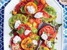 Sliced heirloom tomatoes are wow-worthy on their own--a simple vinaigrette and dollops of basil-flecked ricotta take them over the top....