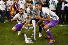 (from L) Real Madrid's Karim Benzema, Enzo Zidane and Raphael Varane pose with the trophy after Real Madrid won the UEFA Champions League final football match between Juventus and Real Madrid at The Principality Stadium in Cardiff, south Wales, on June 3, 2017. / AFP PHOTO / Glyn KIRK