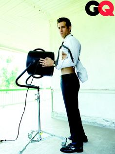 Ryan Reynolds gave a peek at his abs in GQ's October 2010 issue.