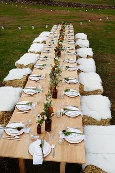 Autumn harvest dinner with sheepskin-covered hay bales.