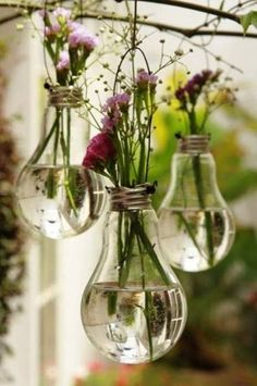 Upcycling, Nordic Folkecenter for Renewable Energy Monnie - Love these little glass hanging vases made out of old light bulbs as it just goes to show all you need is a little imagination and creativity. Anything can be upcycled and have a new use.