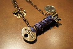 Key wrapped with silk, bronze wire and glass seed beads