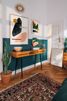 The contrast in this room is perfect with the paint on the wall and how that color matches the color in the wall art.