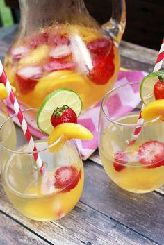 Used mango peach juice, 3 limes, frozen fruit This white wine sangria is the perfect way to cool off on a hot summer day! Party Food And Drinks, Fun Drinks, Beverages, Sangria Recipes, Cocktail Recipes, Drink Recipes, New Recipes, Cooking Recipes, Favorite Recipes