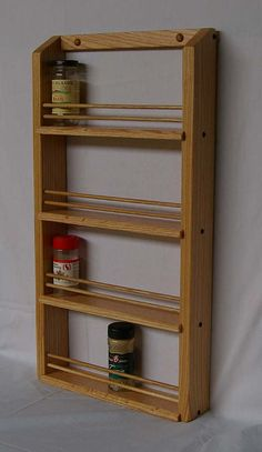 This classic styled spice rack hangs on the wall or on a cabinet door. It is made from solid oak and finished with hand-rubbed Danish oil to highlight the natural beauty of the wood. Handmade in Oregon. Spice Rack Black, Wood Spice Rack, Kitchen Spice Racks, Diy Kitchen Storage, Spice Rack Storage, Wall Mounted Spice Rack, Spice Rack Organiser, Woodworking Projects Diy, Diy Wood Projects