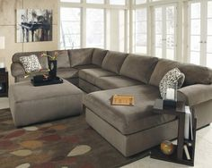 $999 The Jessa Place sectional with its rolled cushions and arms, has ample seating for the entire family. Its reversable, so you can make this piece work for you.