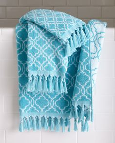 "Turquoise and white ogee pattern. Cotton jacquard. Fringe trim. 16"" x 28"". Machine wash. Imported."