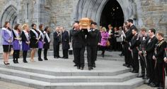 Roses and escorts form a guard of honour as the remains of Dorothy Moriarty Henggeler are carried from St Mary's Cathedral in Killarney. Picture: Eamonn Keogh