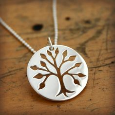 "This sterling silver tree of life necklace features a ""cut-out"" tree design. Shown on a 16"" ball chain. Want it personalized? There's room ..."