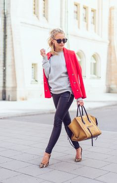 Street Style 2015: Janni Deler is wearing a red River Island blazer with a pale grey sweater, leather trousers and a mustard yellow Céline bag