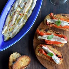 Cured Anchovies. House-Cured Anchovies (aka Boquerones) with Marinated Red Bell Peppers on Grilled/Toasted Bread-- A Spanish Treat! #seafood #recipes Anchovy Recipes, Starters, Seafood Recipes, The Cure, Grilling, Spanish, Stuffed Peppers, Treats, Ethnic Recipes