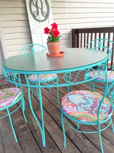 "I bought an old iron patio set at a local antique shop, spray-painted it ""Sea glass"" by Krylon and covered the seats with a cute shower curtain I found at Walmart.  ❤️"