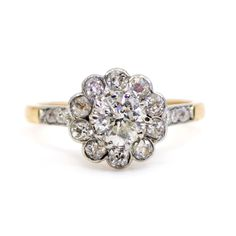 This elegant vintage Edwardian inspired ring feature (H Brilliant Cut Diamond decorated with Old Mine Cut Diamonds in Platinum. Size: NL / FR / 7 US / N½ UK Weight in grams: Condition: Excellent condition - barely used with minimal signs of aging & wear Platinum Diamond Rings, Diamond Cluster Ring, Diamond Cuts, Bridal Jewelry, Jewelry Gifts, Antique Jewelry, Vintage Jewelry, Vintage Diamond, Gold Rings