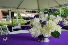 White and Purple centerpiece using hydrangeas, roses and purple statices.
