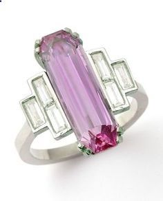 famedguide.com An Art Deco pink topaz and diamond ring, 1930s. Designed as fancy-cut pink topaz weighing 4.57 carats, flanked by three baguette-cut diamonds to each side, mounted in platinum. #ArtDeco #ring