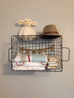 Cute nursery storage idea: hang a wire basket on the wall to hold diapers, blankets, etc! #nursery #storage #organization