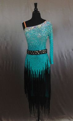 Shop ballroom dancing gowns by Julia Gorchakova, Natalia Gorchakova and their team. Custom costumes and jewelry for women and menswear in smooth, latin...