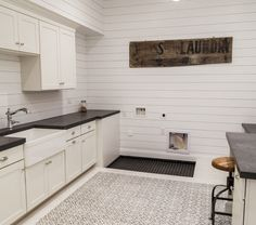 Is this tile or a rug? Storage/utility room stenciled floor, or rug for laundry