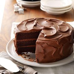 Sandy's Chocolate Cake Recipe -Years ago, I drove 4-1/2 hours to a cake contest, holding my entry on my lap the whole way. But it paid off. One bite and you'll see why this velvety beauty won first prize. —Sandra Johnson, Tioga, Pennsylvania
