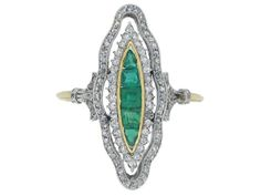 Antique emerald and diamond ring, circa 1900.