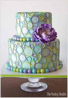 Pink, Blue, Green and purple on cream with a cute bride topper would look good for the Bridal Shower