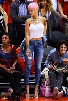 Pink hair, don't care! Rihanna wears skinny jeans and a camo with her Manolo Blahnik Chaos Cuff Sandals in Pink.
