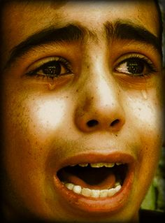 The face of sorrow. A child mourning on the Gaza strip. He most likely just experienced the loss of one or more family members. So sad. (Photo by Hatem Moussa)