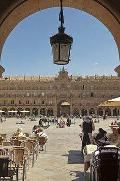 Plaza Mayor , Salamanca Spain - I had the best roast pig of my life in a restaurant in Plaza Mayor. A long winding staircase descended beneath the plaza to a magical place that housed a clay oven where the scrumptious delicacies were cooked. Amazing memory!