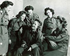 Actress Marlene Dietrich visits with women of the Women's Army Corps somewhere in France 18 November 1944. WWII Signal Corps Collection ~