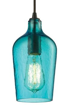 Elk Lighting's hammered glass pendant exposes a vintage-style filament bulb for an effulgent effect, offered in aqua, amber, red and clear.