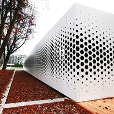 I like the exploration of perforation scale up to window size. Format Elf Architekten added a pattern of hexagonal holes to the long aluminium facade of this office building in Germany to control the amount of daylight entering the interior Architecture Paramétrique, Contemporary Architecture, Architecture Diagrams, Chinese Architecture, Architecture Portfolio, Futuristic Architecture, Building Skin, Building Facade, Building Design