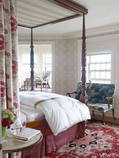 Canopy bed in Jasper and Robert Kime fabrics. Linens, Nancy Koltes. Settee upholstered with 17th-century tapestry, Yew Tree House. Wallpaper, Morris & Co. Michael S. Smith design.