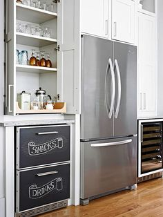 If your base cabinets double as drawers for treats and drinks, fashion the area into a snack station. Chalkboard paint on cabinet doors helps guests determine the drawer's contents, while a tray on the countertop above holds napkins, straws, and other dining accessories.