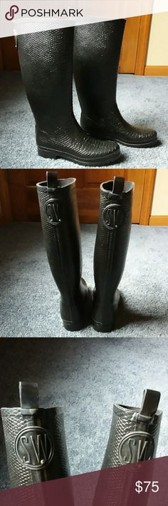 Stuart Weizmann Black Faux Snakeskin Rain Boots These gorgeous rain boots are by Stuart Weizmann. Size 8. The color is black. Faux snakeskin texture on the rain boots. They are in good condition. Does have some wear on the back of the loops that are on the boots. Also, some light wear on the bottom sides of the boots. If you have any questions please let me know. Feel free to make an offer! Stuart Weitzman Shoes Winter & Rain Boots