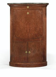 A BURR ambony SECRETARY SEAT, BIEDERMEIER oval, opening a drawer belt, a flap revealing a record and a series of five drawers and two doors at the bottom, resting on a plinth above fossilized gray marble en suite with the following lot