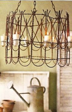 Chandelier for the porch. Take a couple of those little garden wire fence pieces, wire them together forming your circle, flip it upside down and attach some rope or rusty chain, then take a few glass insulators and attach them to the outside with some more wire...and you've got a pretty hanging light.