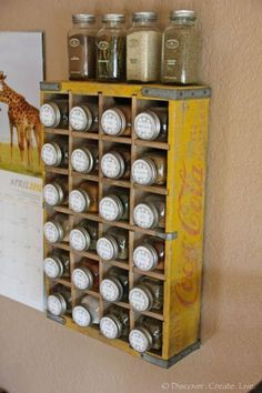 Spice jars in an old Coke crate....